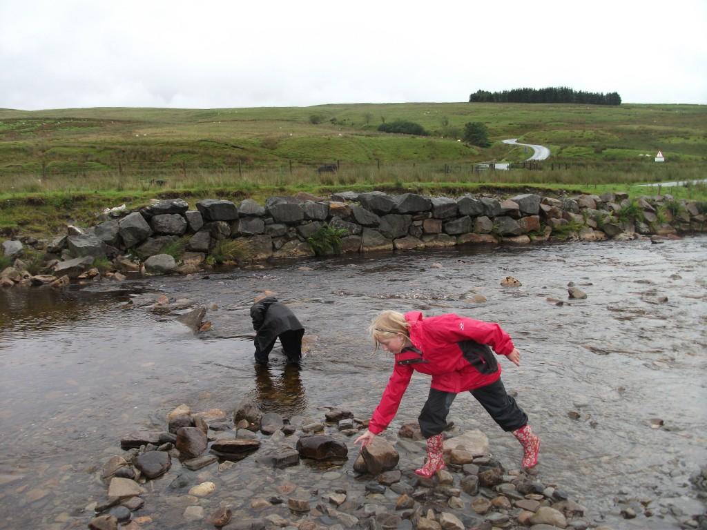 Xene and Lochlan building a dam