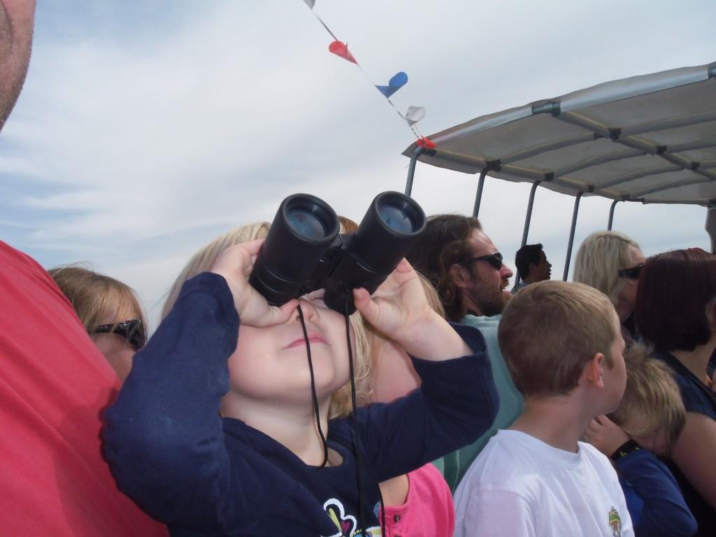 Eowyn looking through binoculars