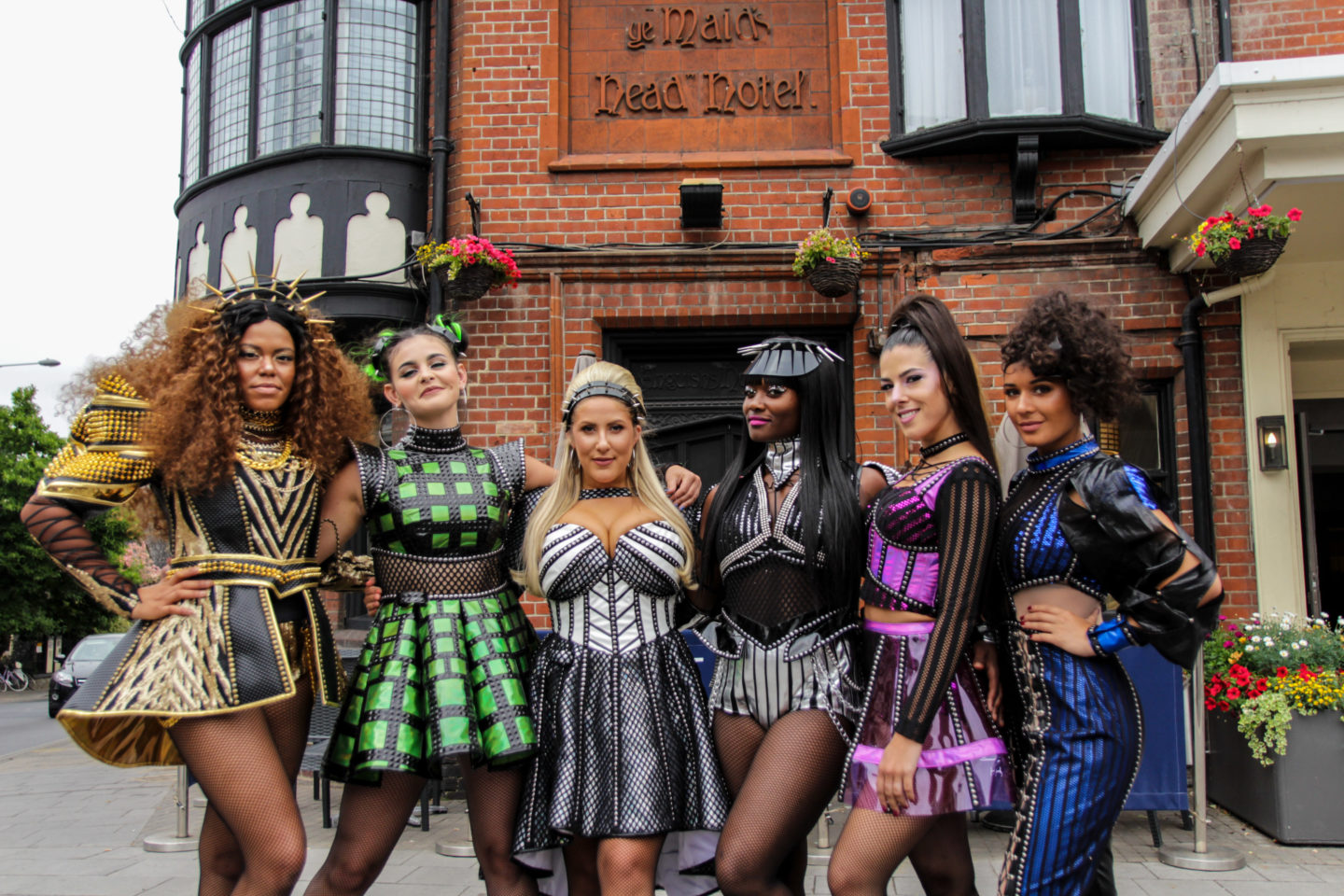 Six The Musical Cast members outside Maids Head Hotel Norwich