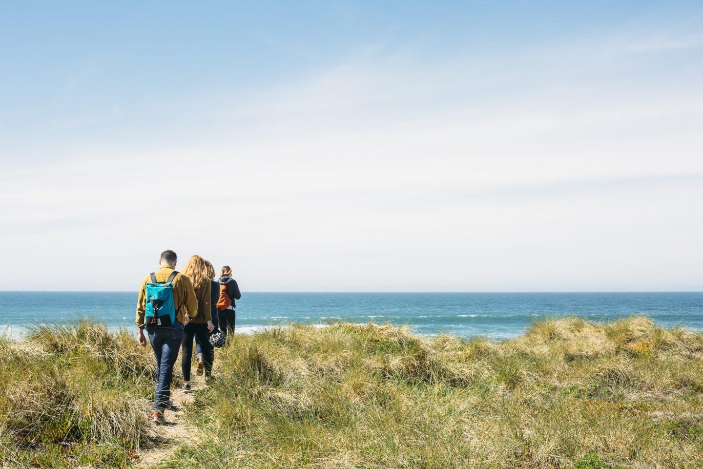 multi-generational travel walking along a coastal path