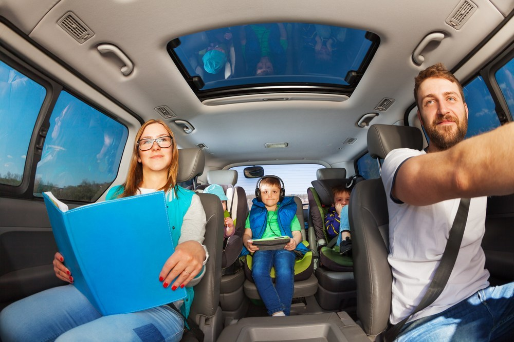 Travel Games For Kids and Adults playing on electronic devices
